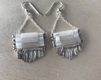 "The white jade and mother of pearl ""Carmine"" earring has irregular length handforged silver fringe, silver chain and sterling earwire"