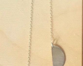 "The ""Quincy"" necklace, an asymmetrical handcut sterling silver necklace with a matte finish 22 1/2 inch chain"
