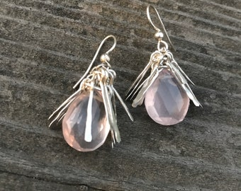 "The ""Gertrude earring"", a tassel made of hand forged silver fringe topping a rose quartz teardrop bead and a sterling silver earwire"