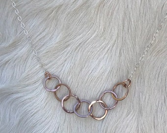 "Alicia necklace is 20"" long Sterling silver with a series of larger 14k Rose Gold links in the center"