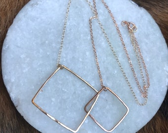 """The 18"""" Lydia necklace is one large 14k gold fill square and one small 14k rose gold square each on matching metal chains"""