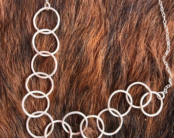 Sterling silver link necklace with a series of larger links in the center