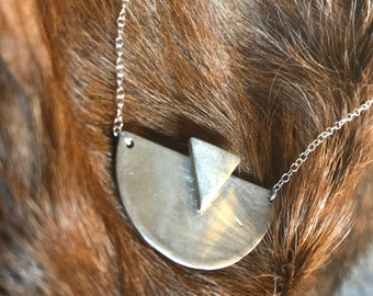Adrian bib necklace: half circle with a triangle layered atop made of sterling silver with silver chain large size