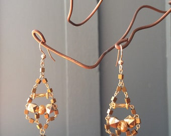 "The ""Trixy"" earring made of wooden, glass, acrylic beads, silver fish hook and gold plated disc beads"
