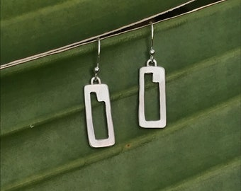 The iconic  handmade SquareColored earring, sterling silver rectangle with geometric cutout