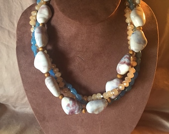 "The ""Betty"" - three strand twisted necklace: blue, purple, cream swirled porcelain beads, brown wooden beads, blue and beige glass beads"