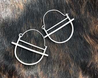 "The ""kandy"" earring is three layers of brushed silver structured and rounded"