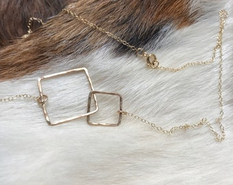"The 20"" long Lydia necklace is made of two 14k gold fill interlocking similarly sized squares connected to a chain"
