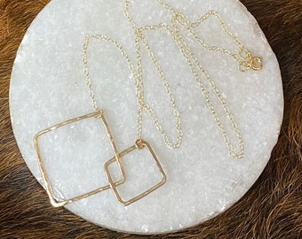 """The 20"""" long Lydia necklace is made of two 14k gold fill interlocking contrasting sized squares"""