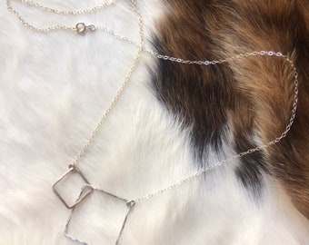"The 20"" long Lydia necklace, made of a 14k gold fill interlocking square and a sterling silver square, each connected with matching chain"