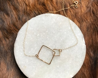 """The 17 1/2"""" long Lydia necklace is made of two 14k gold fill interlocking similarly sized squares connected to a chain"""