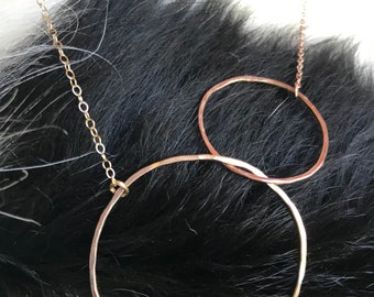 The Lydia necklace is two interlocking circles, one 14k gold fill and one 14k rose gold with 18 inch matching metal chain