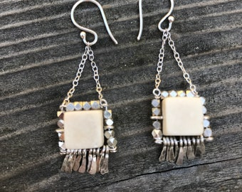 "The ""Carmine"" earring: white riverstone, silver plated multi faceted beads with hammered silver fringe"