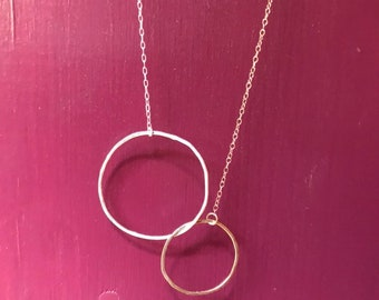 The Lydia necklace is one large 14k gold fill one small silver interlocking circle with half a sterling sliver half gold chain, 18 inch long
