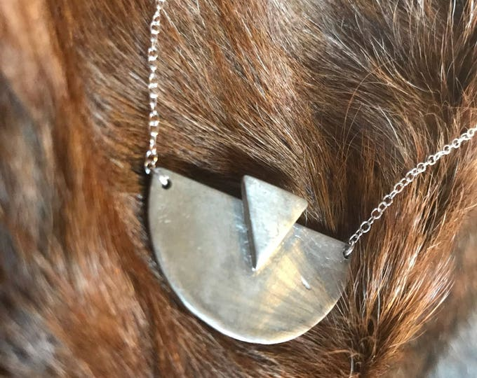 "Featured listing image: The ""Adrian"" necklace of a half circle with one triangle layered on the necklace pendant"
