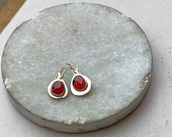 Abstract Pomegranate earrings made of fine silver and garnet stones