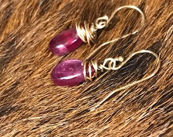 Darla earring: ruby teardrop shaped earring with gold fillwire and earwire