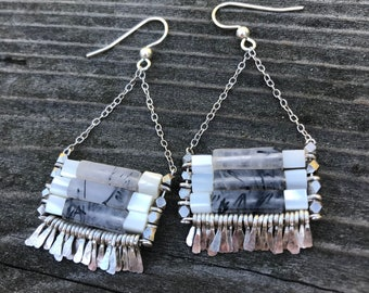 "The ""Carmine"" earring: black rutilated quartz and mother of pearl with silver chain, earwire, hand forged fringe."