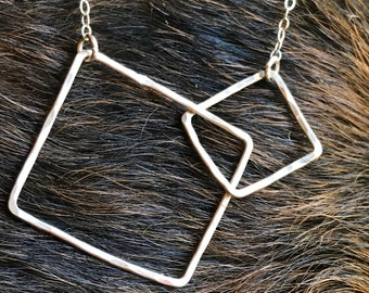 "The 22"" long Lydia necklace is made of two sterling silver interlocking squares of contrasting size connected to a sterling sliver chain"