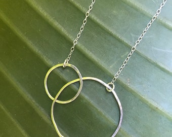 "The 22"" Lydia necklace is made of two sterling silver interlocking circles of contrasting size connected to a sliver chain"