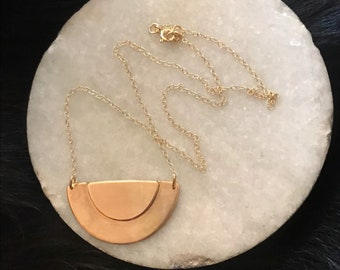 """The Adrian necklace of two half circles layered up on the necklace pendant made of 14k gold fill,  2""""x1"""" and 18"""" overall necklace length"""