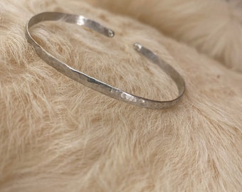 Hand textured sterling silver cuff bracelet with balled ends, medium size, fits 7-9 inch wrist