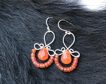 The Emma earring: hand formed sterling silver wire with a orange carnelian teardrop bead and a string of orange carnelian round beads