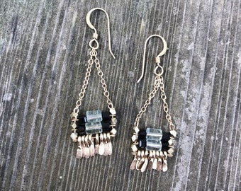 """Fluorite and black glass cube beaded """"Carmine"""" earring has irregular length handforged gold fringe, gold chain and gold  earwire"""