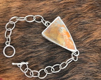 """The """"Alicia"""" handmade oval chain link and set  bumblebee jasper stone bracelet measuring 7 and 1/4 length closed with a toggle clasp"""