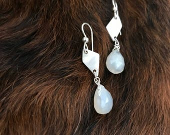 """The """"Josie"""" earring, handcut and refined silver diamond shape, a white colored chalcedony briolette shaped bead and a sterling silver hook"""