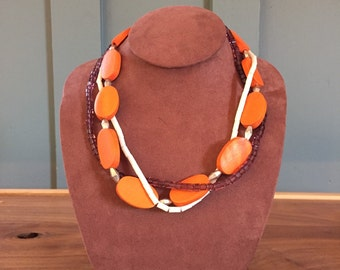 """The """"Betty"""" necklace - three strand twisted necklace with glass, wooden, and coral beads 19 and 1/2 inches long"""