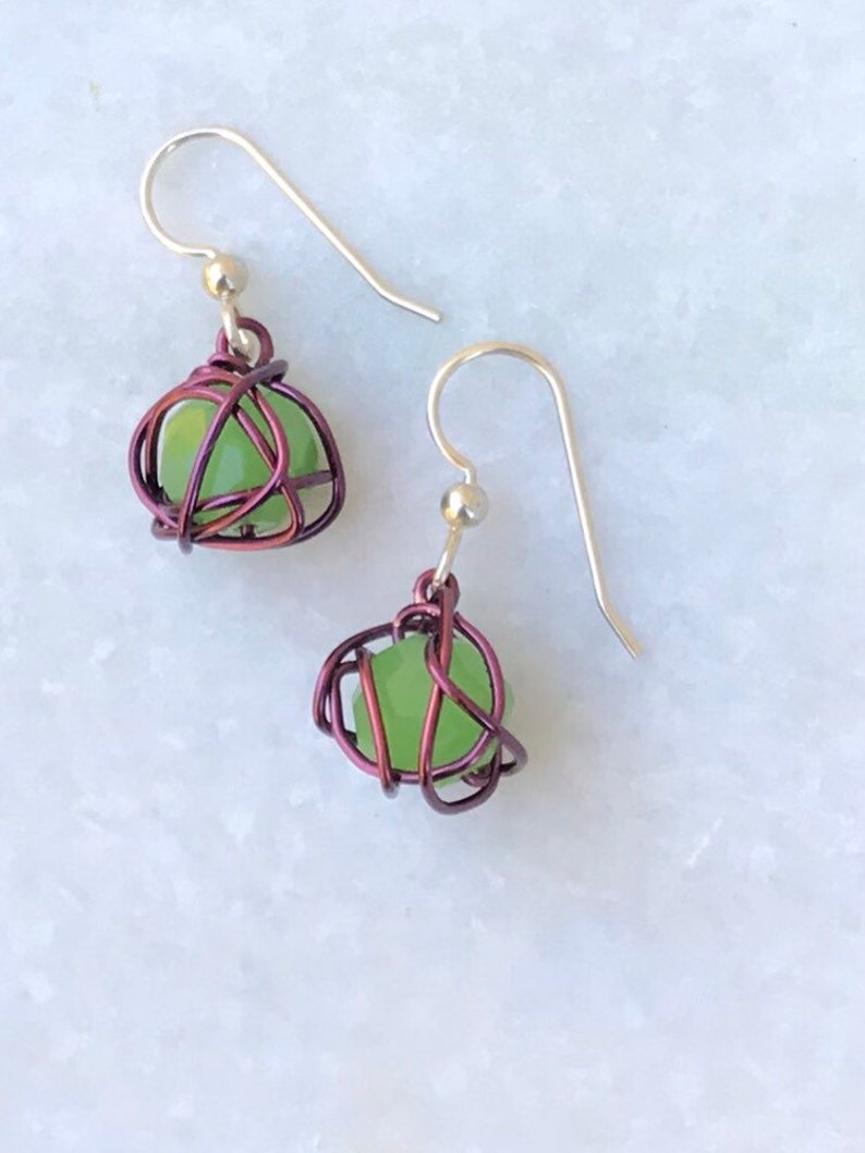 Leesa earring: bright green glass bead with purple colored image 0