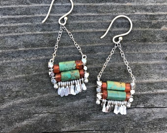 """The turquoise and orange carnelian bead """"Carmine"""" earring has hand forged silver fringe with silver chain and silver fishhook"""