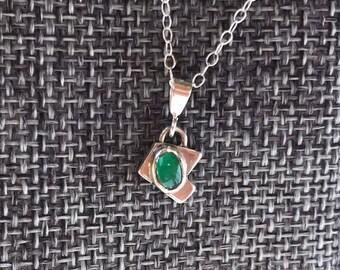"The ""Ingrid"" green onyx pendant with an angular and irregular shaped metal baseplate"
