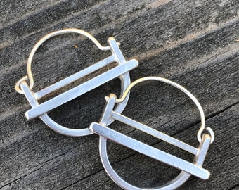 """The small """"kandy"""" earring is three layers of brushed silver structured and rounded"""