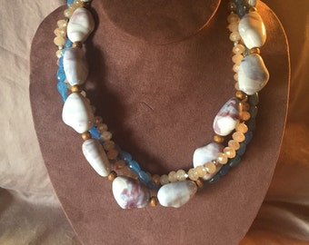 """The """"Betty"""" - three strand twisted necklace: blue, purple, cream swirled porcelain beads, brown wooden beads, blue and beige glass beads"""