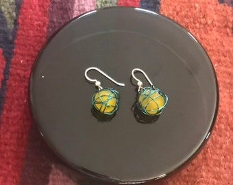 Leesa earring: Recycled yellow glass bead wrapped with teal colored wire and sterling silver earwire