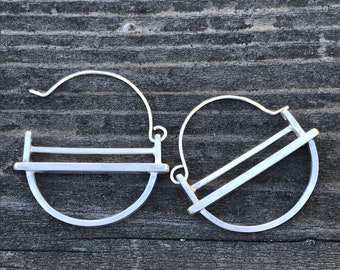 """The medium """"kandy"""" earring is three layers of brushed silver structured and rounded"""