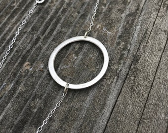 The circle necklace, made of fine sliver by hand on a 19 1/2 inch sterling silver chain