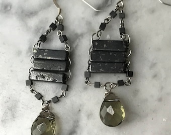 """The """"Trixy"""" earring made of pyrite, hematite, glass, acrylic beads, silver fish hook and glass grey tear drop shaped bead"""