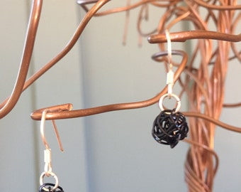 """The """"Shay"""" earring: a single handformed wireball of black wire and silver fish hook"""