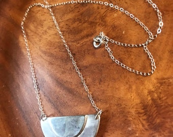 """The Adrian necklace of two half circles layered up on the necklace pendant large version 2""""x1"""" and 20"""" overall necklace length"""