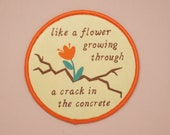 Flower Growing Through Concrete Iron-On Patch | Iron on patch, Iron on patch flower, Patch, Patches, Patches for jackets, Patch for backpack