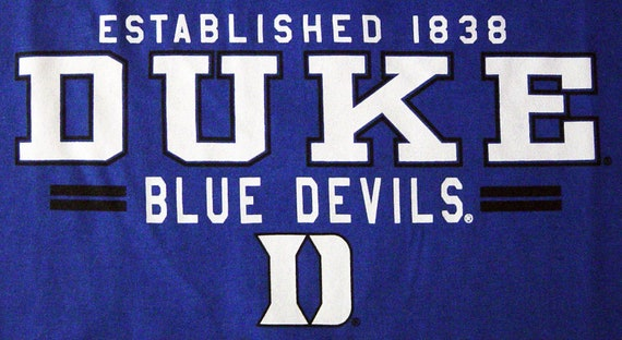 Duke Shirt Long Sleeve T Shirt Blue Devils College University Logo Decal Clothing Gifts Womens Mens Apparel Officially Licensed By The NCAA