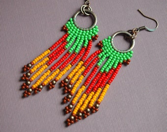 color block seed bead fringe earrings. beaded dangle earrings in mint green, tomato red, and light orange. copper and contrasting colors