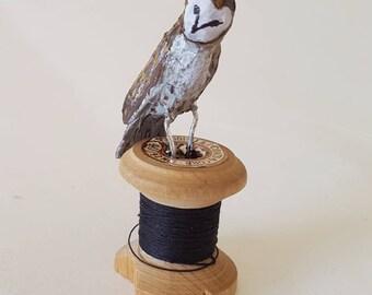 Tiny minature papier mache owl on a cotton reel