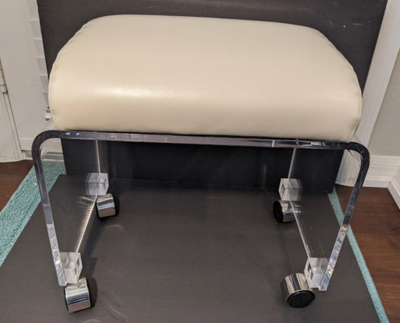 Vintage Mid-Century Modern Lucite Rolling Vanity Bench. Lucite Vanity Stool with Faux Cream Leather Cushion. Waterfall Lucite Vanity Bench
