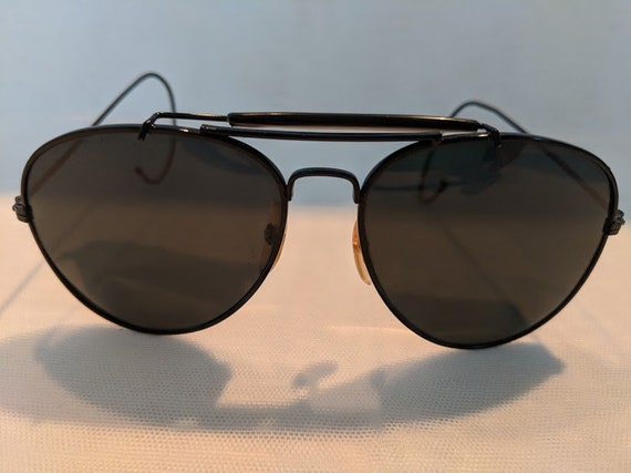 Black / Vintage Large Aviator Sunglasses With Cable Ear Pieces. Black Aviator Sunnies With Impact Resistant Glass Lenses. Cool Wire Aviators