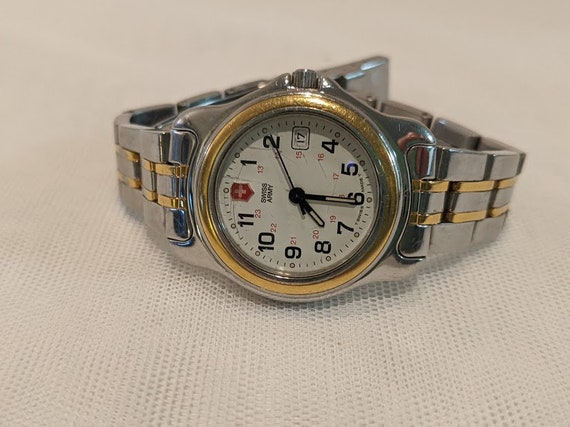 Vintage Swiss Army Women's Casual- Sports Watch.  Swiss Army 330 Feet Water Resistant.  Swiss Army Watch/ Two Tone Adjustable Band.