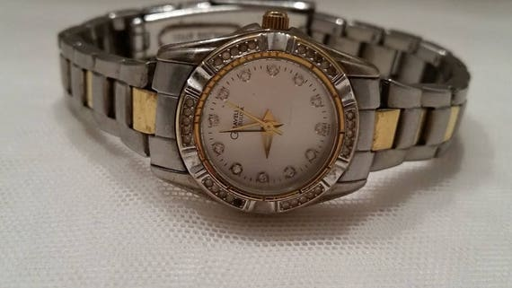 Vintage Caravelle by Bulova Women's Wrist Watch. Bulova Women's Dress Watch. Mother of Pearl and Diamond Dial Bulova Wrist Watch.